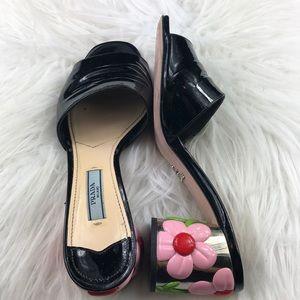 Prada Calzarure Donna patent floral heel slides